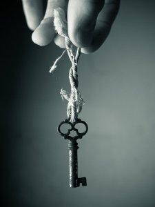 holding_a_key_by_johnkyo-d39g8qr